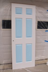 "Painted closet door with the blue ""Windows"""