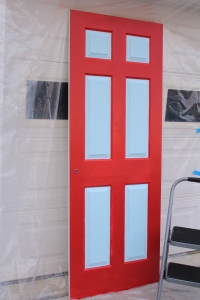 Painted door with the red for the booth